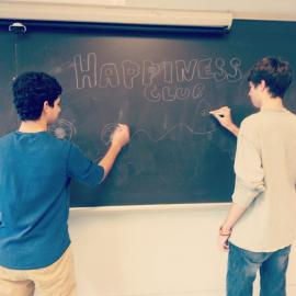 Happiness Club co-founder, Jonah Kaul promoting the club with sophomore Matt Dineen.Photo by Danny Mendleson