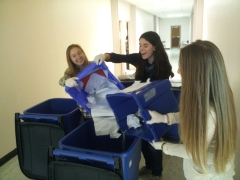 Julia Weiss, Molly Charney and Casey Tilles empty recycling bins