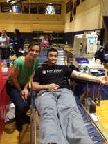 Denise Haxhia supports Chris Marinaccio as he gives blood